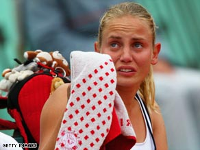 Jelena Dokic was left in tears after being forced to retire hurt against Elena Dementieva at the French Open.