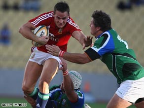 Lions full-back Lee Byrne breaks through a tackle during his side's tour opener in Rustenberg.