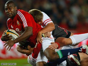 Ugo Monye scored two tries as the British and Irish Lions recorded an emphatic victory in South Africa.