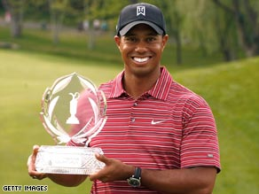 Woods celebrates a record fourth Memorial win and fires a warning ahead of his U.S. Open title defense.