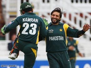 Shahid Afridi of Pakistan celebrates the wicket of Daan van Bunge of Netherlands with Kamran Akmal.