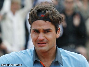 "Roger Federer quits the Halle Open saying he is  ""overwhelmed and exhausted"" after his Paris triumph."