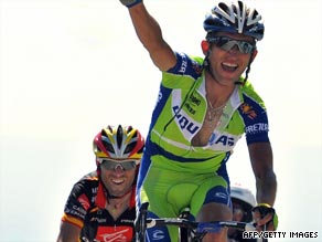 Szmyd celebrates winning on Mont Ventoux as second-placed Alejandro Valverde takes the yellow jersey.