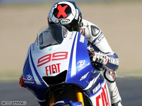Lorenzo edged out world champion Valentino Rossi to take pole position for Sunday's Catalunya MotoGP.