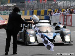 David Brabham steers the Peugeot over the line to win the famous Le Mans 24-hour race on Sunday.