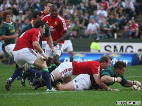 Captain John Smit goes over for the Springboks' opening try in their 26-21 victory over the Lions.
