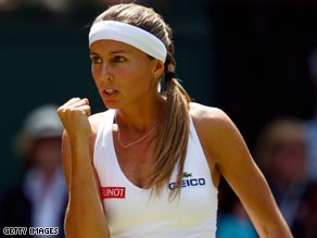 Gisela Dulko of Argentina celebrates beating Maria Sharapova of Russia at Wimbledon.