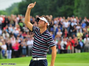 Nick Dougherty celebrates after sinking the winning putt on the 18th hole at the Munich North Eichenried club.