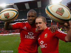Try scorers Ugo Monye (left) and Shane Williams celebrate an emphatic victory.