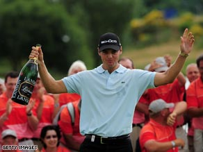 Kaymer celebrates with champagne after his playoff victory.