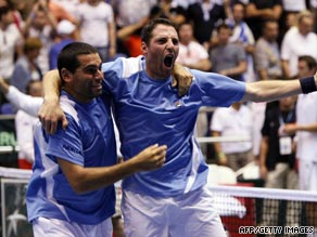 Andy Ram (left) and Jonathan Erlich celebrate Israel's stunning Davis Cup victory over Russia.