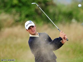 Kaymer practices his bunker play in preparation for the British Open.