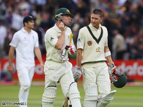 Haddin (left) and Clarke walk off at the end of the fourth day at Lord's.