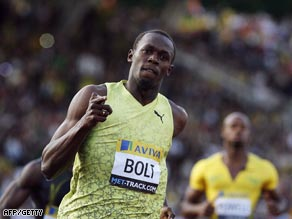 Bolt crosses the line in the 100m in London with Powell left trailing.