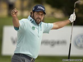 Ricardo Gonzalez celebrates after sinking a bunker shot on the 17th hole of the monster Barseback course.