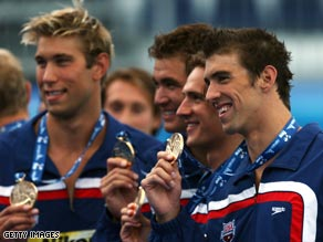 Phelps (far right) and the triumphant U.S. relay squad show off their golds.