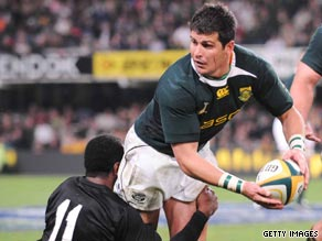 Springboks hero Morne Steyn breaks through the tackle of All Blacks winger Sitiveni Sivivatu.