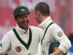 Ponting (left) shakes hands with century maker Clarke as the match is declared a draw.
