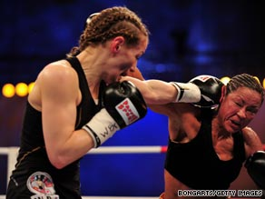 Germany's Ina Menzer, left, fights American Franchesca Alcanter during a WIBF and WBC featherweight bout in May.