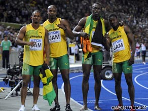 Bolt (second right) celebrates his third gold medal after helping Jamaica to victory in the 4x100m relay.