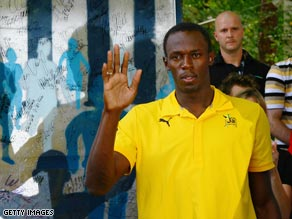 Bolt received a commemorative slab of the Berlin Wall as he celebrated his world championship success.