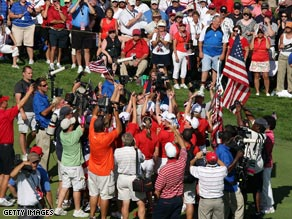 The victorious U.S. team celebrate their Solheim Cup triumph on the 18th green.