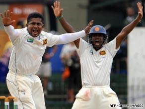 Rangana Herath, left, and Chamara Kapugedara celebrate after the dismissal of New Zealand batsman Jesse Ryder.