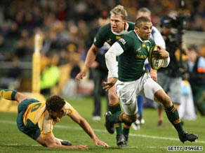 South Africa's two-try winger Bryce Habana bursts free from an attempted tackle by Luke Burgess.