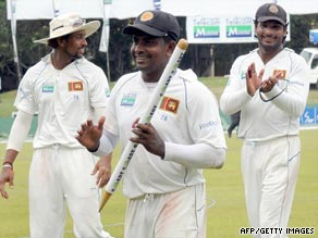Herath claims a souvenir after his five-wicket haul ensured Sri Lanka won the second Test in Colombo.