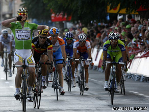 Greipel (left) claims his second sprint victory to take over the race lead in the Vuelta Espana.