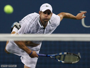 Andy Roddick returns a shot against John Isner.