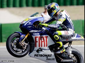 Rossi wheelies his way to victory in his home MotoGP at Misano.