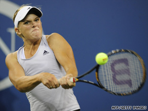 Melanie Oudin of the United States returns a point to Danish player Caroline Wozniacki on Wednesday.