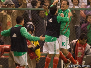 Cuauhtemoc Blanco (center) of Mexico celebrates his goal with teammates against Honduras.