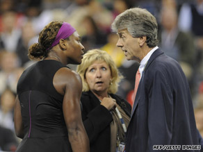 Williams talks to head referee Brian Earley after being penalized in her semifinal against Clijsters.