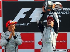 Barrichello celebrates winning the third Italian Grand Prix of his career.