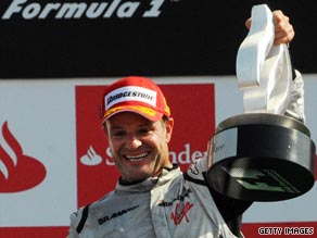 Barrichello celebrates victory at Monza as he moves to within 14 points of Brawn teammate Jenson Button.