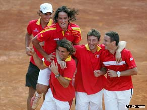 The triumphant Spanish team celebrate their doubles victory in the semifinal.