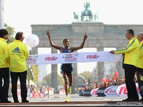 Gebreselassie crosses the finishing line to win the Berlin Marathon for the fourth straight year.