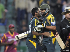 Afridi and Akmal embrace after seeing Pakistan home by five wickets.