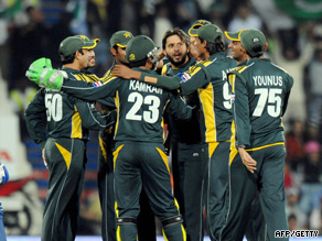 Shahid Afridi is congratulated after claiming a wicket in the Pakistan win.