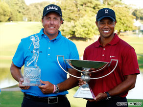 Phil Mickelson, winner of the Tour Championship, poses with Tiger Woods, winner of the FedEx Cup.