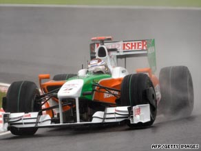 Adrian Sutil's Force India was quickest in a rain-affected second practice session at Suzuka.