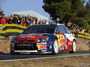 Loeb powered into the lead in the all-conquering Citroen in Catalunya.