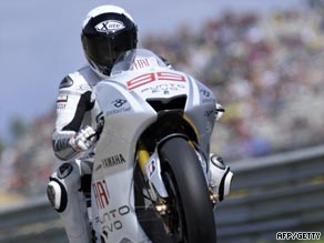 Lorenzo led from pole to claim victory in the Portugal MotoGP and close on title leader Valentino Rossi.