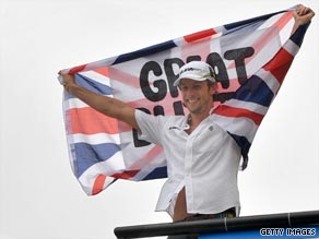 Champion at last. Jenson Button celebrates winning the drivers' championship in Brazil.