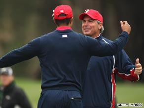 U.S. captain Fred Couples congratulates Woods after his decisive victory.