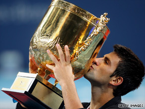 Novak Djokovic holds aloft the giant China Open trophy after victory over Marin Cilic in Beijing.