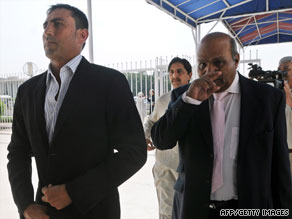 Younis Khan, left, and coach Intikhab Alam arrive for a parliamentary sports committee meeting in Islamabad.