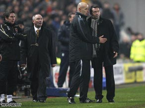 Hull manager Phil Brown (far right) is restrained by fourth official Howard Webb during the penalty incident.